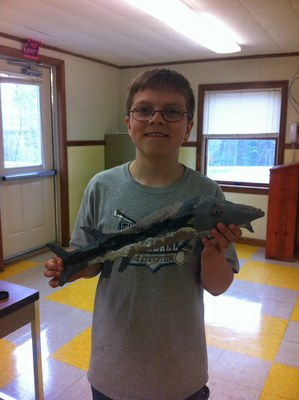Ryan with his own sturgeon at James H. Bean School, Sidney, ME