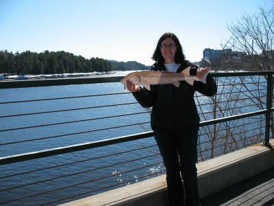 USFWS biologist Wende and sturgeon